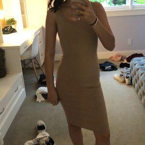 Nude bodycon maxi dress.